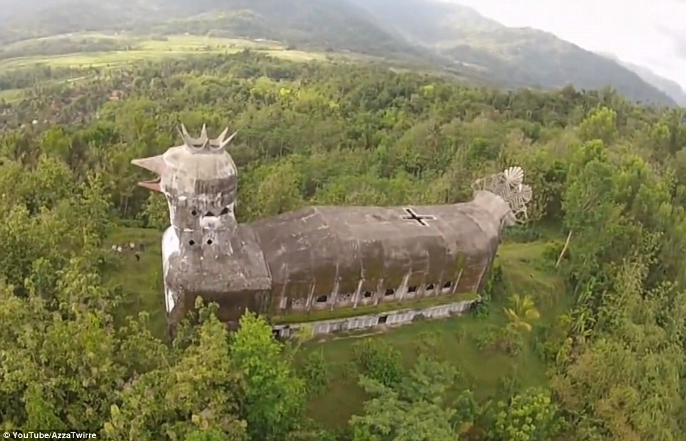 The giant building known locally as Gereja Ayam - or Chicken Church - stands over the trees in a densely wooded area in Indonesia
