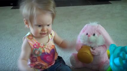 Cute baby dances with the Easter bunny