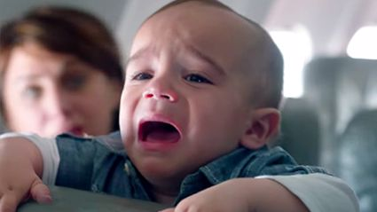 This Stranger's Response To A Crying Baby On His Flight Is The Most Uplifting Thing You'll See All Day