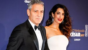 Amal Clooney shows off baby bump in stunning white dress