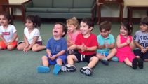 Watch this adorable little boy laugh hysterically in his music class
