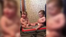 Watch these adorable one-year-old twins have a ball on a fitness machine