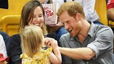 Watch the adorable moment a little girl playfully steals Prince Harry's popcorn