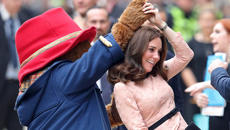 Watch a pregnant Kate Middleton share a dance with Paddington Bear