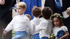 Prince George and Princess Charlotte steal the show as a page boy and bridesmaid at another wedding