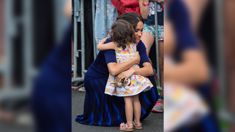 The story behind the hug that Meghan and the adorable little Kiwi girl shared