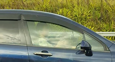 Woman caught texting while child drives