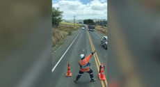 Road worker delights with dancing