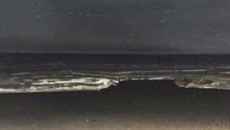 This bizarre optical illusion is majorly dividing the internet ... do you see a beach or a car door?
