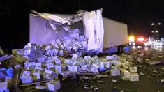 Truck carrying 18,000 kilograms of wine bottles crashes spilling wine all over the road