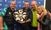 Jason Reeves freaks out as Darts Masters Michael Van Gerwen and Rob Cross throw darts at his face