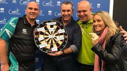 Jason Reeves freaks out as Darts Masters Michael Van Gerwen and Rob Cross throw darts at his face