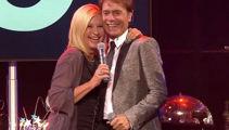 Olivia Newton-John shares a birthday duet with longtime friend Cliff Richard