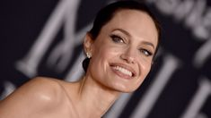Angelina Jolie makes rare public appearance with five of her kids at movie premiere
