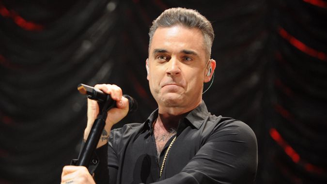 Robbie Williams shares hilarious story about the Queen failing to recognise him - twice!