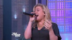 "Kelly Clarkson belts out a soulful rendition of Cher's classic, ""If I Could Turn Back Time"""