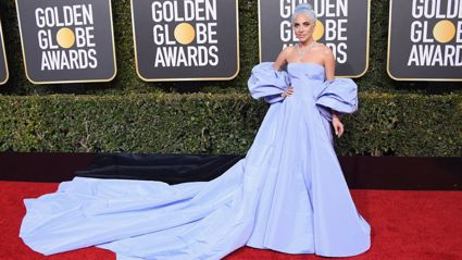 Gaga in the blue Valentino dress, believed to be in homage to Judy Garland from the original 'A Star is Born' film from 1954. Image / Getty