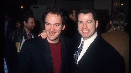 Director Quentin Tarantino and actor John Travolta stand at the Los Angeles Film Critics Awards January 17, 1995 / Getty Images