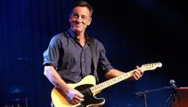 Bruce Springsteen performs with Sheryl Crow at New York benefit show