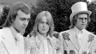 Bernie Taupin, Maxine Feibelman and Elton John on Bernie & Maxine's wedding day. 1971 / Getty