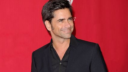 John Stamos' baby mistakes picture of Elvis Presley for his dad in adorable video