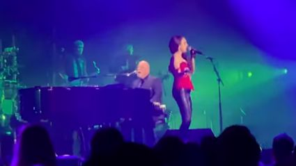 Billy Joel performs rock rendition of 'White Christmas' with his daughter