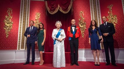 The figures of the Duke and Duchess of Sussex in their original positions next to Queen Elizabeth II, the Duke of Edinburgh, and the Duke and Duchess of Cambridge, as Madame Tussauds London moved its figures of the couple from its Royal Family set / Getty Images