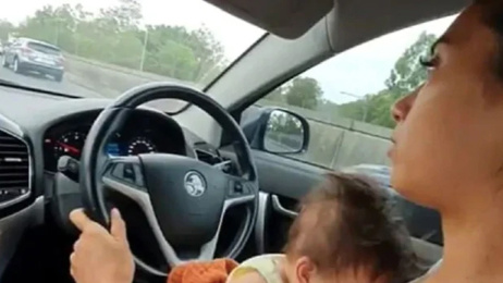 Australian mum sparks controversy after posting a video of herself breastfeeding while driving