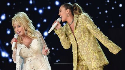 Dolly and Miley performing at the Grammy awards in 2019 / Getty Images