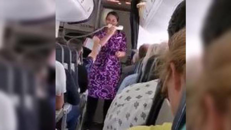 Watch: Air New Zealand hostess belts out amazing Simon & Garfunkel cover on delayed flight