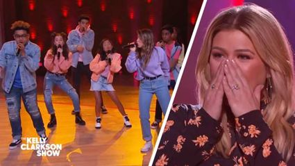 Kelly Clarkson blown away by kid acapella group performing a medley of her hits