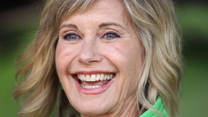 Olivia Newton-John says shes winning her breast cancer battle as her tumours have shrunk