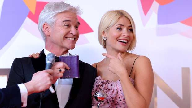 Holly Willoughby and Phillip Schofield pose with the Daytime Award in the winners room during the National Television Awards. Getty Images