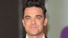 Robbie Williams reveals he underwent cosmetic surgery as he feared ageing