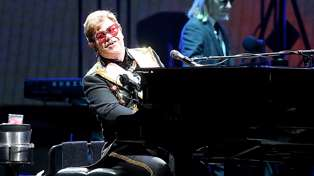 "Elton John updates his fans following a ""tough week"" being diagnosed with pneumonia"
