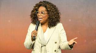 Oprah Winfrey dramatically faceplants on stage while ironically talking about balance