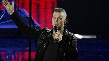 Robbie Williams reveals he was asked to join Queen before Adam Lambert