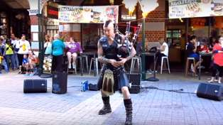 Australian street performer plays epic rendition of AC/DC's 'Thunderstruck' on flaming bagpipes