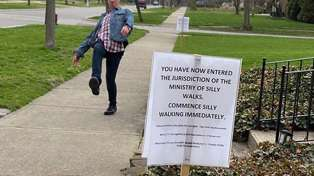 Here's How People React To A Sign On The Sidewalk Telling Them To 'Commence Silly Walking'