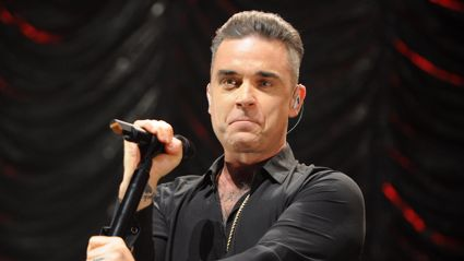 Robbie Williams performs upbeat reggae remix of 'Angels' with The Horne Section band