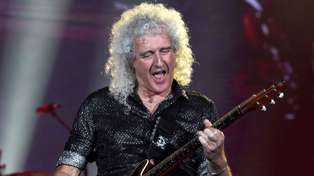 Queen's Brian May updates fans with a message from hospital after injuring himself