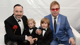 Elton John and young sons sing 'Crocodile Rock' in adorable costumes to mark Halloween