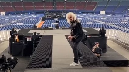 Queen shares spine-tingling video of Brian May playing a guitar solo to an empty stadium