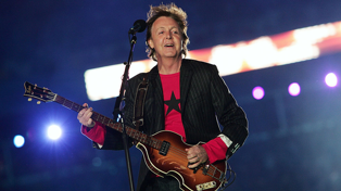 Paul McCartney admits he uses an autocue on stage to stop him thinking about food