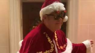 Elton John dresses up as Santa Claus with his two sons in adorable 'Step Into Christmas' video