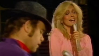 Relive Olivia Newton-John and Elton John's stunning stripped-back rendition of 'Candle In The Wind'